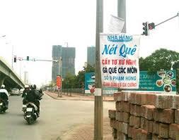 15. Có nên treo biển quảng cáo tại các đèn đường trên phố.ảnh 1